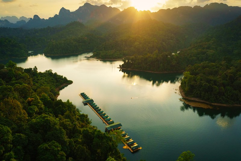 Elephant Hills Rainforest Camp Cheow Larn Lake Khao Sok National Park Thailand at sunset